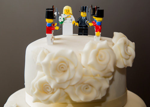 Lego cake topper on plain white cake