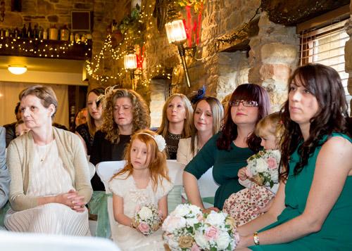 Bridesmaids watching the wedding ceremony