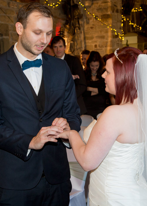 Bride and groom exchange rings at Cubley Hall