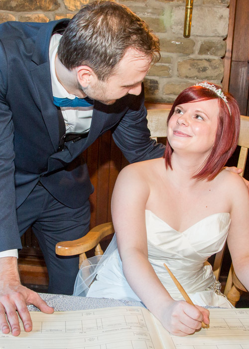 Signing the register at Cubley Hall Wedding