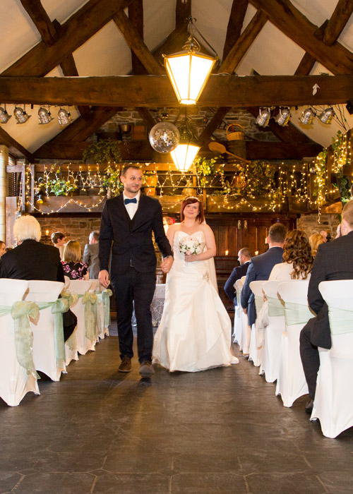Bride and groom walk back down the aisle at Cubley Hall Wedding
