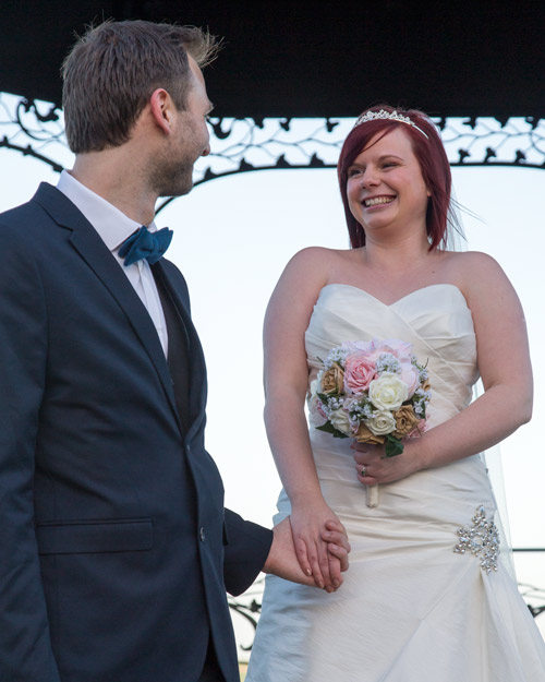 Bride and groom hold hands at Cubley Hall