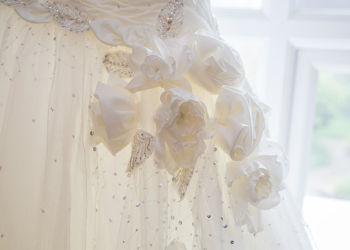 flower and diamante details in the wedding dress before its worn