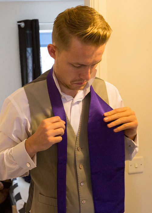 the best man trying to tie his cadbury purple cravat