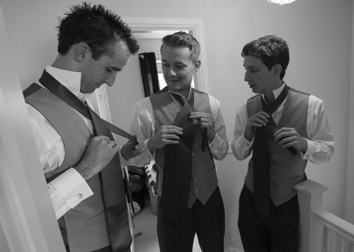 the groomsmen tying their cravats