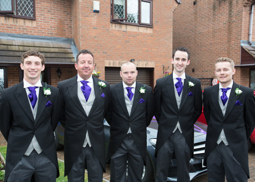 the groom with the groomsmen before they leave for church