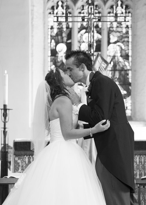 bride and grooms first kiss as a married couple in aston church sheffield