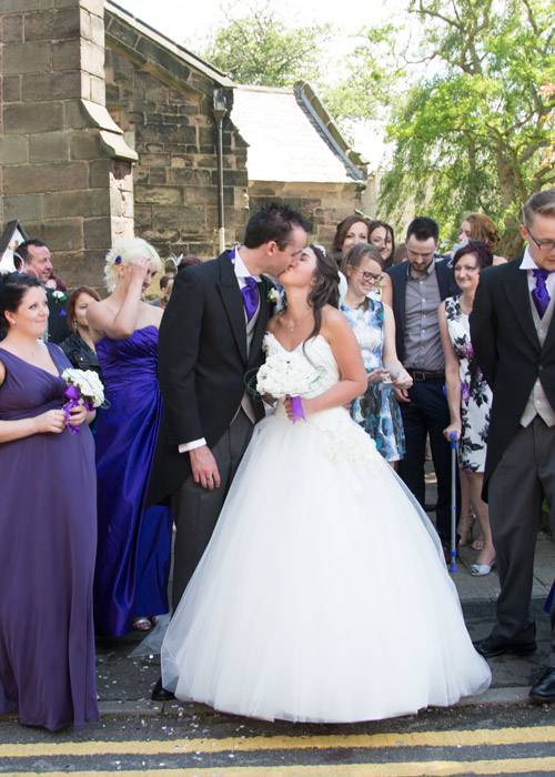 bride and groom kiss outside aston church sheffield