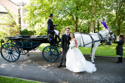 bride and groom with horse and carriage at aston hall hotel