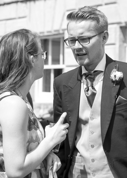 groomsman talking to guests in the grounds of aston hall hotel