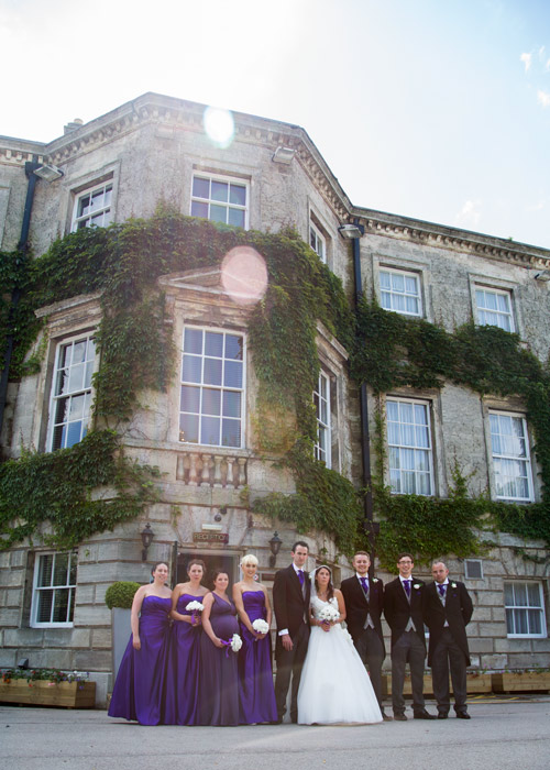 Bridesmaids with groomsmen bride and groom outside aston hall hotel sheffield