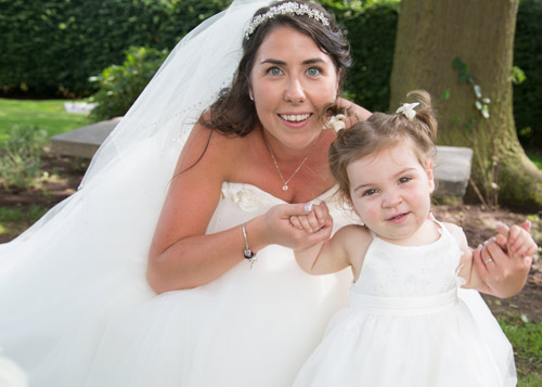 bride with flowergirl at aston hall hotel grounds