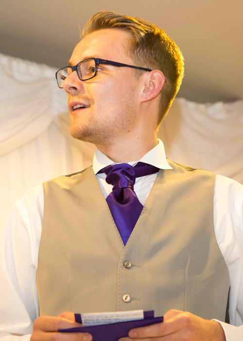 best man in purple cravat givig speech