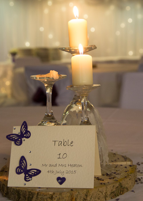 homemade centrepiece purple and white with butterflies and candles