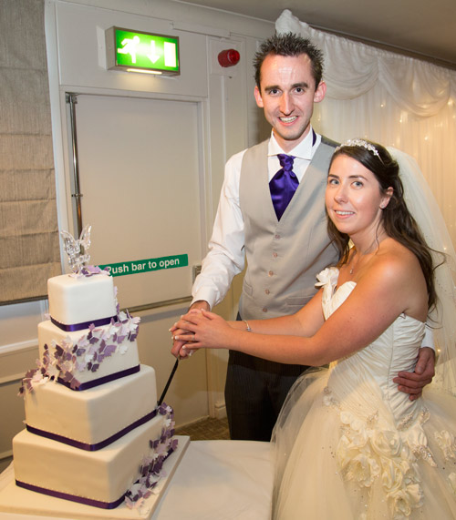 Bride and groom official cake cutting photograph at Aston hall hotel