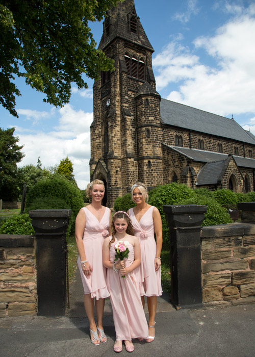 bridesmaids waiting for bride to arrive outside monk bretton church barnsley