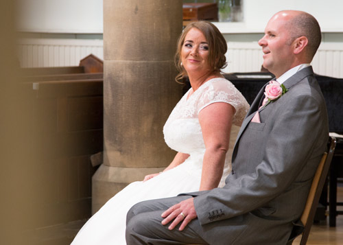 bride and groom facing the congregation during readings in monk bretton church barnsley