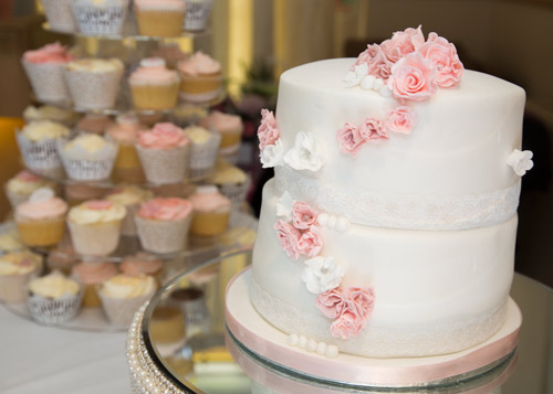 pink and white wedding cake and bun tower