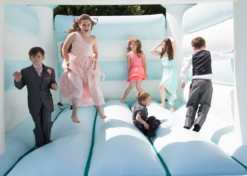 children of the wedding on the bouncy castle