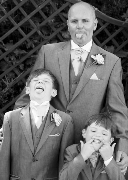 groom and sons pulling faces black and white bluebell banqueting suite wedding barnsley photographer