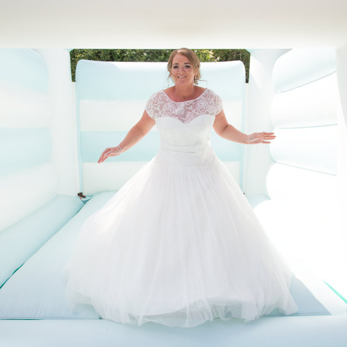 bride on bouncy castle jumping bluebell weddings barnsley