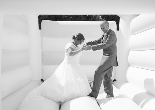 bride and groom on bouncy castle wedding black and white barnsley photography