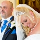bride looking down and smiling with groom teary eyes