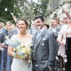 bride and groom looking left during confetti