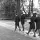 groom and groomsmen walking to the church with the buttonholes in a cardboard box