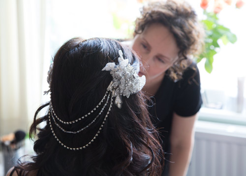 bride having hair annd makeup done on the morning of the wedding