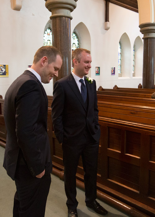 groom and best man waiting for guests to arrive st edwards church barnsley