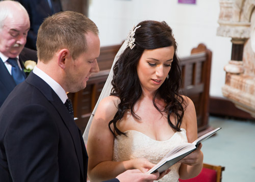 bride and groom reading the order of service