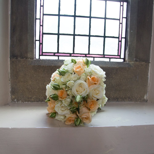bouquet peach white and green on church window sill