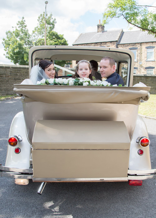 bride and groom in wedding car barnsley photographer
