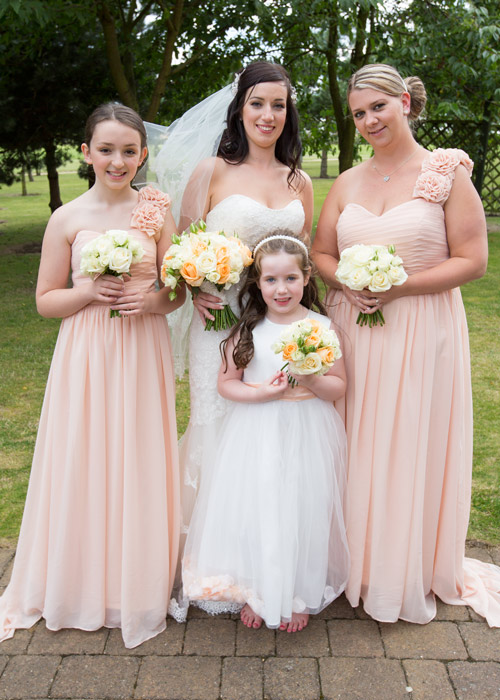 bride and bridesmaids in peach dresses at burntwood court hotel barnsley photographer