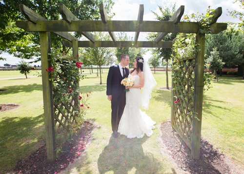 Bride and groom in grounds of burntwood court hotel summer wedding