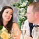 bride and groom looking at each other during and smiling in the receptio room