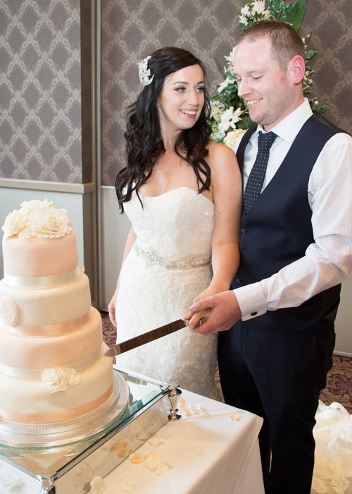 Bride and groom cutting cake burntwood court hotel