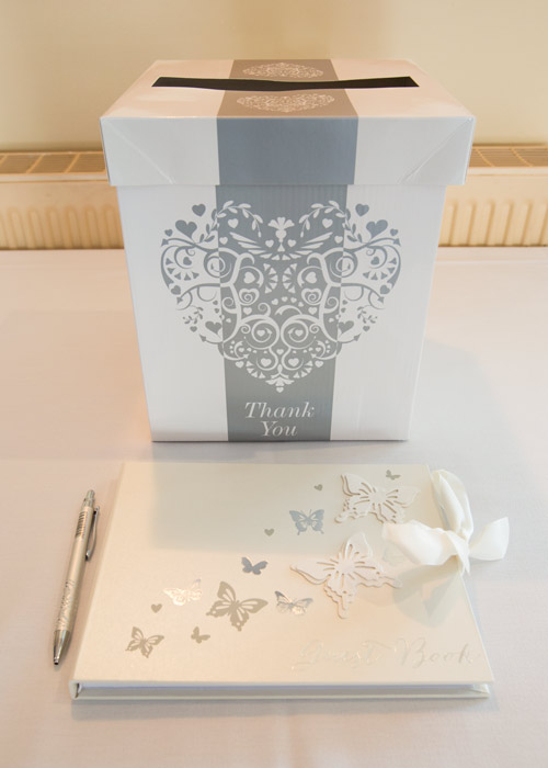 silver and white thank you card box and guest book