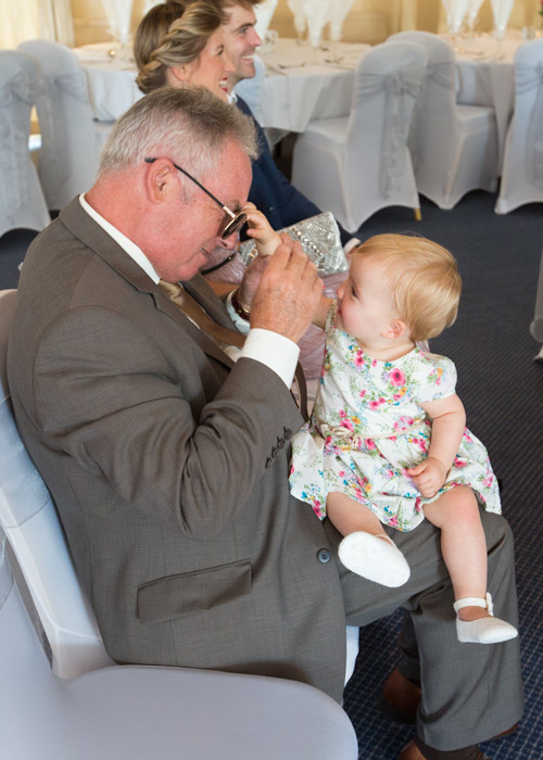 baby stealing glasses during wedding ceremony