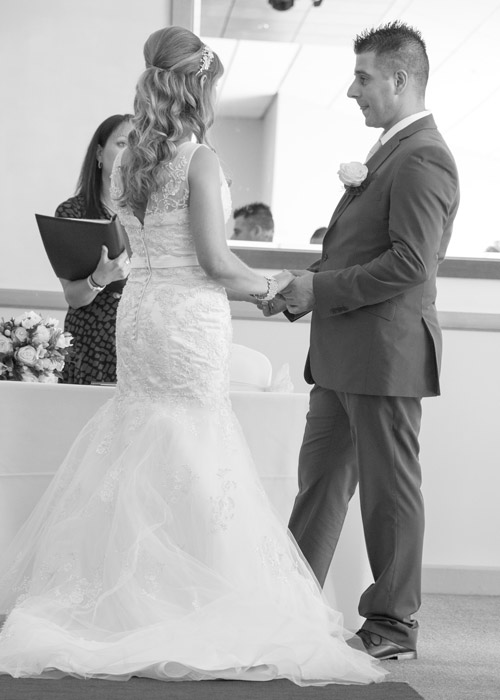 black and white photography bride and groom exchange wedding vows