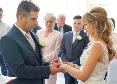 wedding vows with guests in the background barnsley