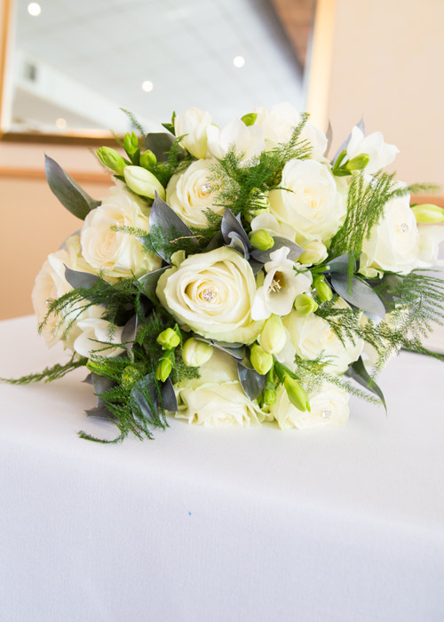 white wedding bouquet with diamante centre and foilage