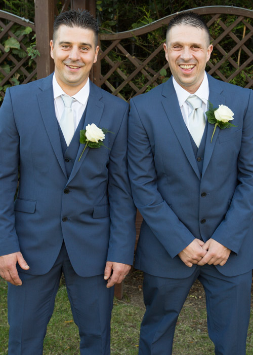 groom and best man laughing at fairway wedding barnsley