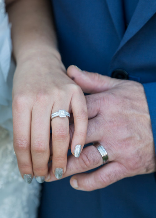 bride and groom wedding rings photography