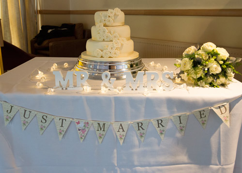 white and silver theme cake table and decorations barnsley bluebell banqueting suite wedding
