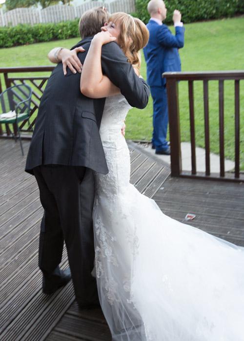 bride hugging guest natural wedding photography