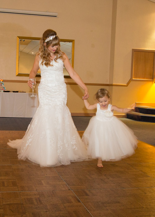 Bride and daughter in white dresses at the bluebell banqueting suite barnsley