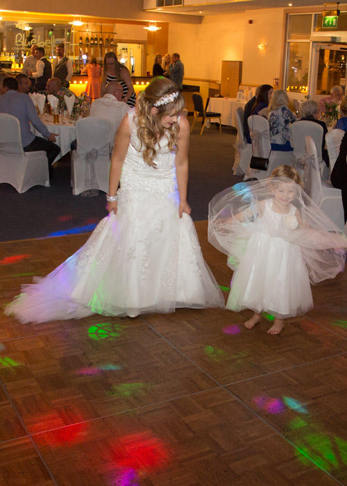 bride and flower girl dancing on the dancefloor at the evening redeption