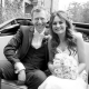 black and white bride and groom in wedding car